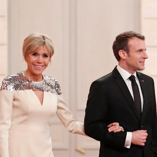 The French First Lady Brigitte Macron opted for a floor-skimming dress with a shimmering silver finish.