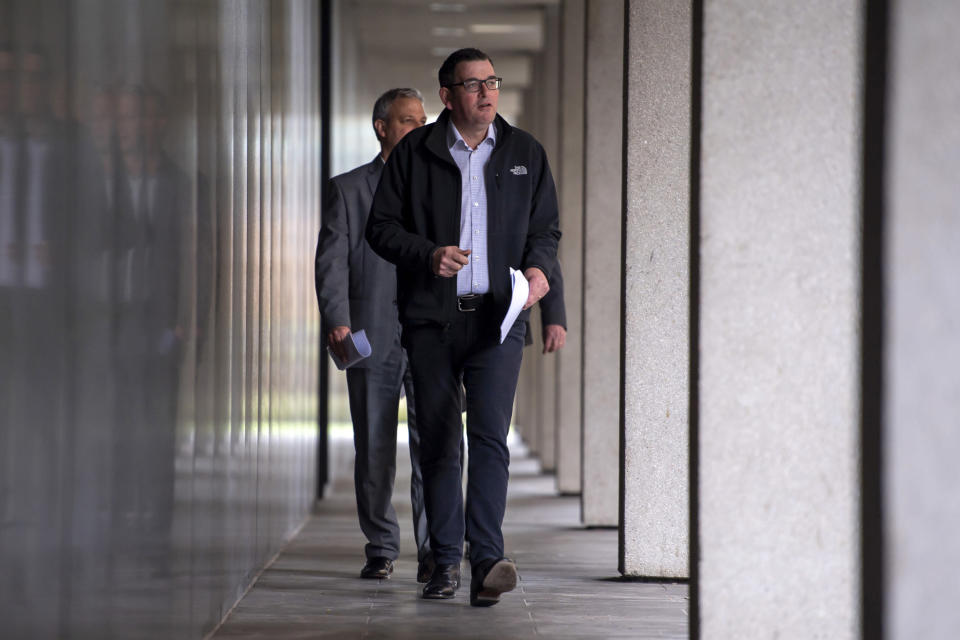 Victorian Premier Daniel Andrews walks to a press conference in Melbourne, Monday, July 6, 2020. As Australia is emerging from pandemic restrictions, the Victoria state capital Melbourne is buckling down with more extreme and divisive measures that are causing anger and igniting arguments over who is to blame as the disease spreads again at an alarming rate. (AP Photo/Andy Brownbill)