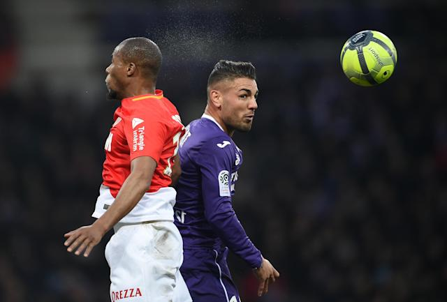 Soccer Football - Ligue 1 - Toulouse vs AS Monaco - Stadium Municipal de Toulouse, Toulouse, France - February 24, 2018 Monaco's Djibril Sidibe in action with Toulouse's Andy Delort REUTERS/Fred Lancelot