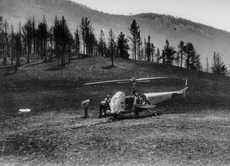 The body of a Mann Gulch fire victim is loaded aboard a helicopter in an August 1949 photo. The August 5, 1949 fire near Helena, Mont., killed 12 smokejumpers and a forest ranger. The Forest Service chartered this early helicopter to help in removal of the bodies from the remote mountain gulch where the victims died. On Thursday August 5 the U.S. Forest Service marks the 50th anniversary of the Mann Gulch fire, the first major catastrophe to befall what was then a still-young Forest Service smokejumper program and, until 1994, unsurpassed in the number of firefighter deaths in a single blaze. (AP Photo/USDA US Forest Service)
