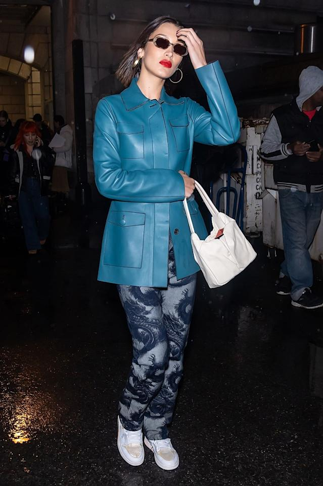 <p><strong>10 February </strong>Bella Hadid stepped out in a blue leather shirt and patterned trousers. <strong></strong></p>