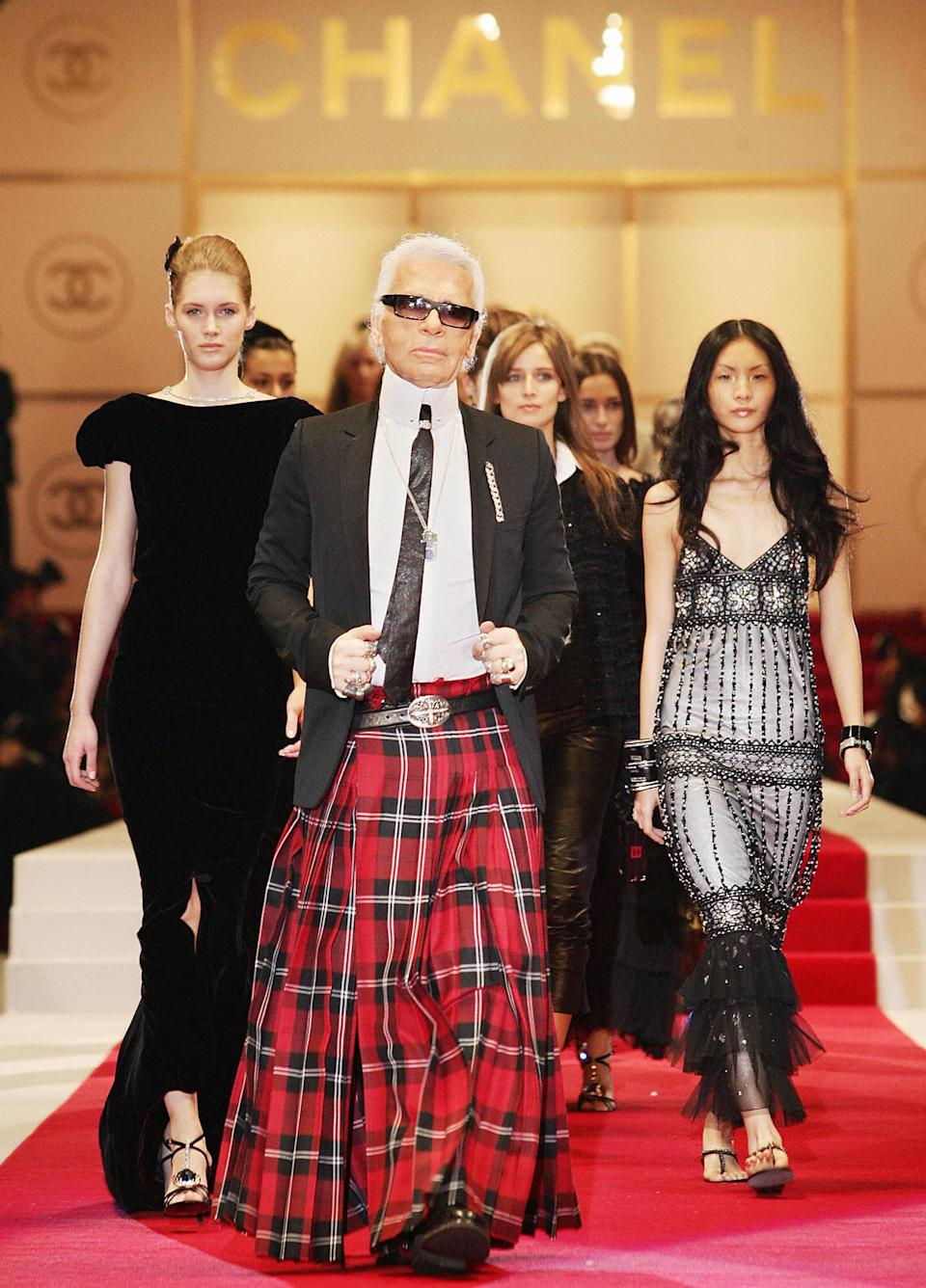 <p>Karl Lagerfeld eschewed his traditional suit in favour of a kilt at the SS15 show in Tokyo. <em>[Photo: Getty]</em> </p>