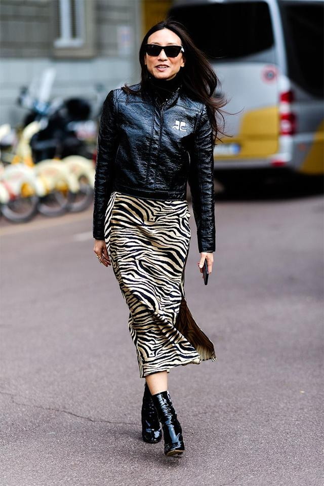 """<p>Add a little edge to a silk slip skirt by styling it with a leather jacket and booties. </p><p><strong>Get the look: Free People</strong> slip skirt, $98, <a href=""""https://shop.nordstrom.com/s/free-people-normani-leopard-print-bias-cut-midi-skirt/5218702"""" target=""""_blank"""">nordstrom.com</a>.</p><p><a class=""""body-btn-link"""" href=""""https://go.redirectingat.com?id=74968X1596630&url=https%3A%2F%2Fshop.nordstrom.com%2Fs%2Ffree-people-normani-leopard-print-bias-cut-midi-skirt%2F5218702&sref=http%3A%2F%2Fwww.harpersbazaar.com%2Ffashion%2Fstreet-style%2Fg7872%2Ffall-autumn-outfits%2F"""" target=""""_blank"""">SHOP NOW</a></p>"""