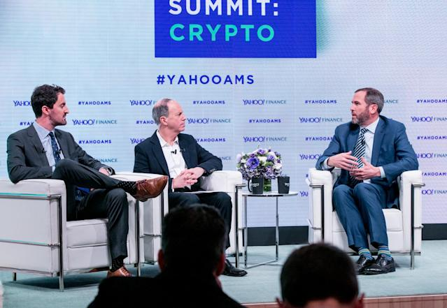 L-R: Yahoo Finance's Daniel Roberts and Andy Serwer interview Brad Garlinghouse, CEO of Ripple, at the Yahoo Finance All Markets Summit: Crypto on Feb. 7, 2018. (Gino DePinto/Oath)