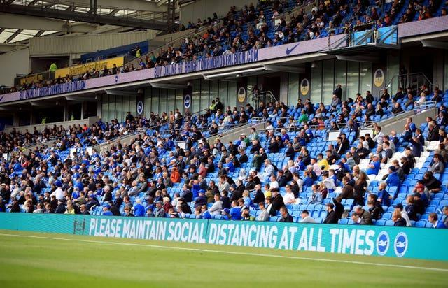 Fans attend a pilot event at Brighton's Amex Stadium