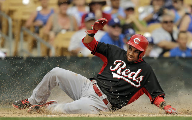 Cincinnati Reds' Billy Hamilton scores on a single hit by Jay Bruce in the third inning of a spring exhibition baseball game against the Los Angeles Dodgers, Thursday, March 13, 2014, in Glendale, Ariz. (AP Photo/Mark Duncan)