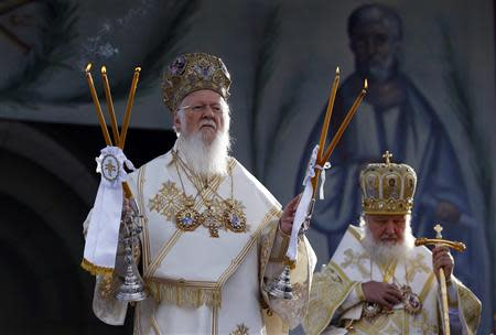 Patriarch Kirill of Moscow and All Russia (R) and Ecumenical Orthodox Patriarch Bartholomew I hold a liturgy to mark 1,700 years since the Edict of Milan, when Roman emperor Constantine issued instructions to end the persecution of Christians, in the southern Serbian city of Nis October 6, 2013. REUTERS/Marko Djurica