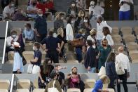 Spectators leave to respect the 11PM curfew due to the COVID-19 pandemic while Italy's Matteo Berrettini plays Serbia's Novak Djokovic in a quarterfinal match of the French Open tennis tournament at the Roland Garros stadium Wednesday, June 9, 2021 in Paris. (AP Photo/Michel Euler)