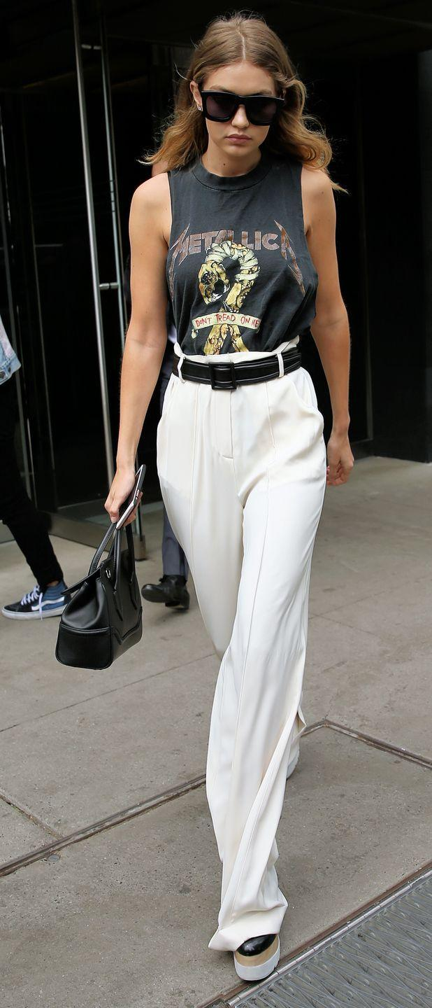 <p>The 21-year-old model wore high-waisted white pants that accentuate her long legs while out shopping in New York City. She paired them with Stella McCartney shoes and a Metallica tank top.</p>