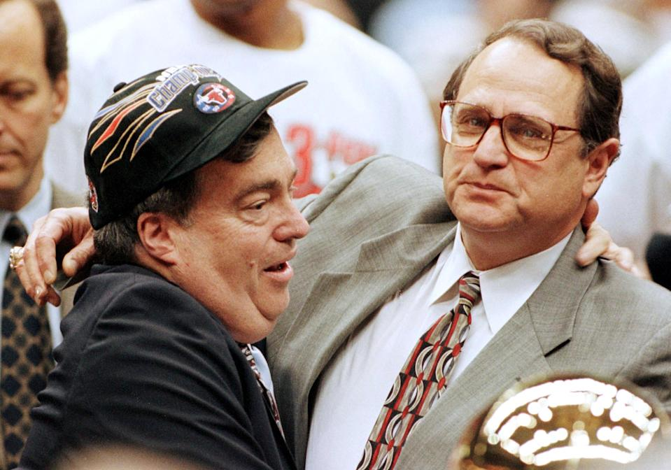 Chicago Bulls General Manager Jerry Krause (L) and team owner Jerry Reinsdorf (R)  celebrate14 June after the Bulls won game six of the NBA Finals against the Utah Jazz at the Delta Center in Salt Lake City, UT. The Bulls won the game 87-86 for their sixth NBA Championship.   AFP PHOTO/Jeff HAYNES (Photo by Jeff HAYNES / AFP)        (Photo credit should read JEFF HAYNES/AFP via Getty Images)