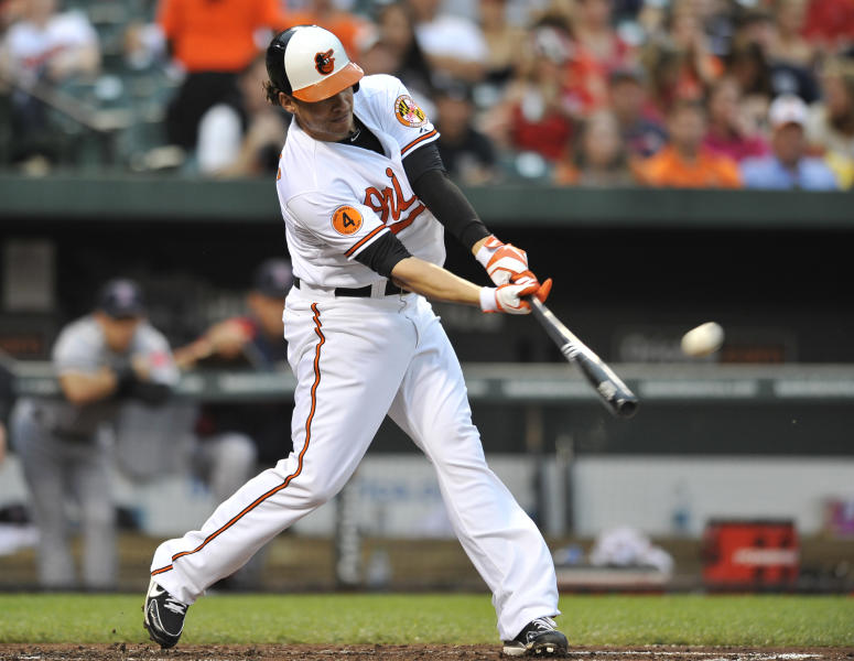 Baltimore Orioles' Danny Valencia connects for a solo home run against the Boston Red Sox in the third inning of a baseball game on Thursday, June 13, 2013, in Baltimore. (AP Photo/Gail Burton)