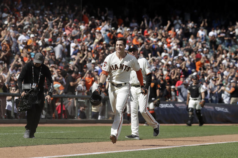 San Francisco Giants' Mike Yastrzemski, center, celebrates after hitting a solo home run against the New York Mets during the 12th inning of a baseball game in San Francisco, Sunday, July 21, 2019. (AP Photo/Jeff Chiu)