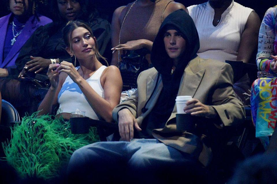<p>The couple might have skipped the red carpet but they still made a show-stealing stop at the MTV VMAs on September 12. After presenting on the stage in a stunning lilac Alaia dress, Hailey changed into a white crop top and green feathered trousers to support Justin from the audience when he won the 'Artist of the year award'.</p><p>Thanking his 'beautiful wife' during his acceptance speech a blushing Hailey blew Justin a kiss while cheering him on.</p>