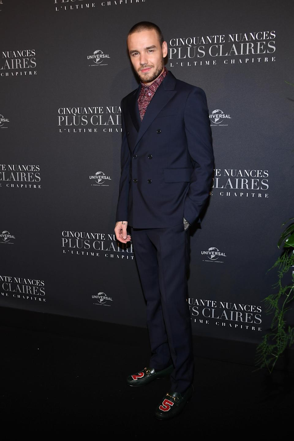 <p>The new dad looked dapper in a navy suit and '25' leather shoes. <em>[Photo: Getty]</em> </p>