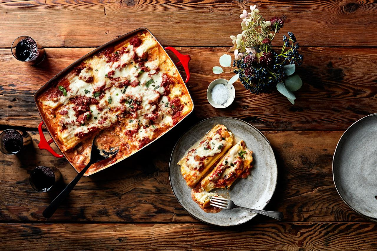 "Stuffing manicotti noodles is a very good way to spend an afternoon (especially if there's a bottle of red wine open). A spoon works fine, but a piping bag—while it may seem fussy—makes quicker work of the assembly. <a href=""https://www.epicurious.com/recipes/food/views/four-cheese-manicotti?mbid=synd_yahoo_rss"">See recipe.</a>"