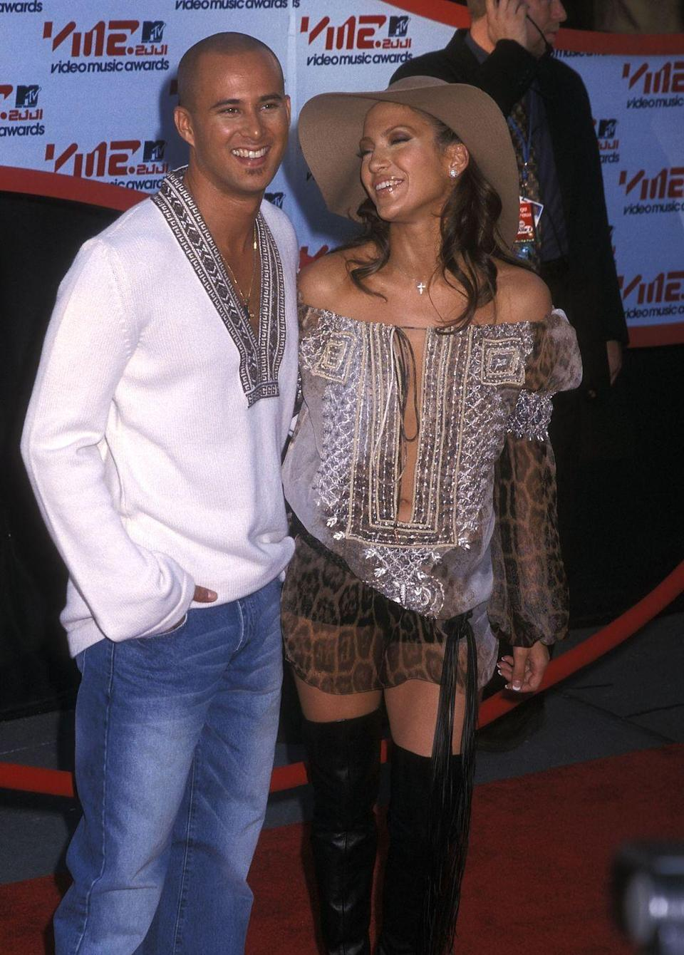 <p>Jennifer Lopez rocked a summer-holiday-meets-safari-meets-night-on-the-town look for her 2001 VMAs appearance.</p>