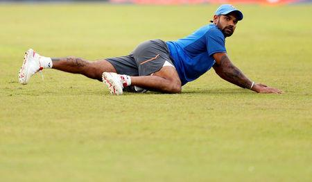 Cricket - Sri Lanka v India - India Team's Practice Session - Colombo, Sri Lanka - August 30, 2017 - India's Shikhar Dhawan stretches ahead of their fourth One Day International match against Sri Lanka. REUTERS/Dinuka Liyanawatte