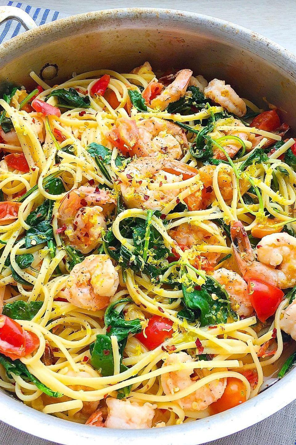 """<p>Don't give up pasta, just add some greens and skip the heavy sauces.<br><br>Get the recipe from <a href=""""https://www.delish.com/cooking/recipe-ideas/recipes/a43809/creamy-shrimp-linguine-tomatoes-kale-lemon-zest-recipe/"""" rel=""""nofollow noopener"""" target=""""_blank"""" data-ylk=""""slk:Delish"""" class=""""link rapid-noclick-resp"""">Delish</a>.</p>"""