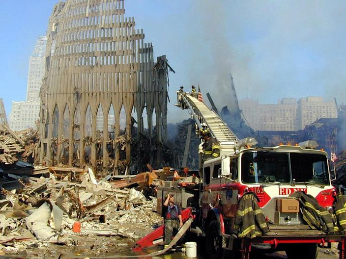 <p>Remains of the facade of Two World Trade Center is all that stands on the World Trade Center site, Sept. 12, 2001. (Photo: AP) </p>
