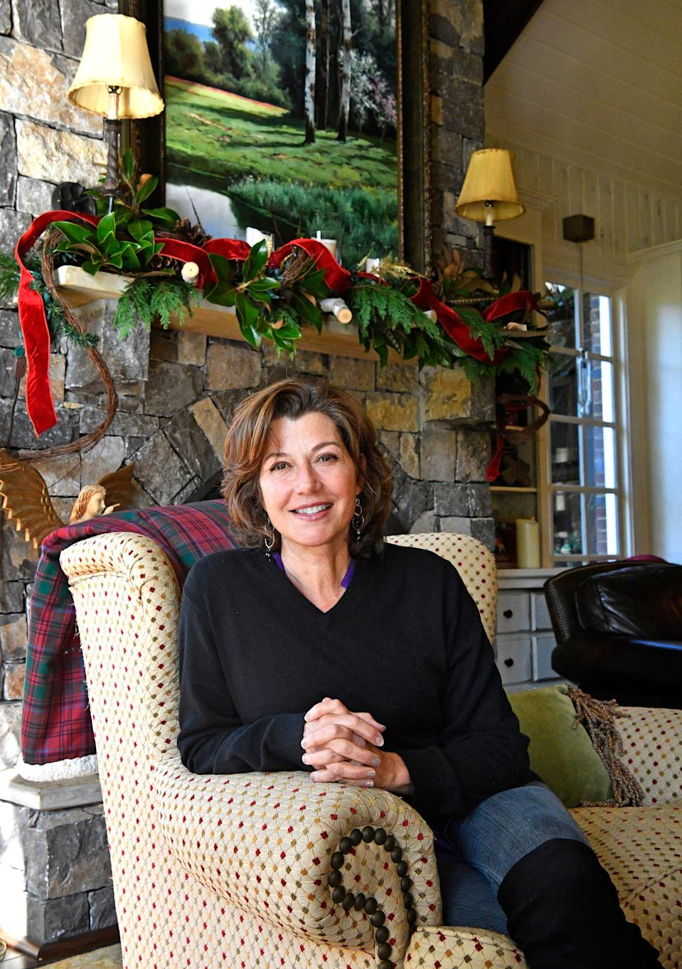 Amy Grant poses in her Belle Meade home she shares with husband Vince Gill in Nashville, Tenn. Friday, Oct. 16, 2020.