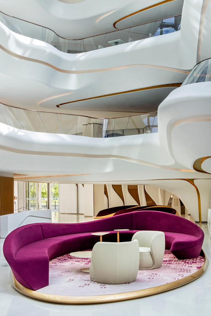"""<p><strong>Why book?</strong> It's the only hotel in the world designed inside and out by the late, Pritzker-awarded architect Dame Zaha Hadid, so there's no better way to experience her work than within this immersive work of art. Buzzy and curvaceous, it's now attracting the city's jet set.</p> <p><strong>Set the scene:</strong> Surrounded by the skyscrapers of Business Bay and in the shadow of neighboring Downtown <a href=""""https://www.cntraveler.com/destinations/dubai?mbid=synd_yahoo_rss"""" rel=""""nofollow noopener"""" target=""""_blank"""" data-ylk=""""slk:Dubai"""" class=""""link rapid-noclick-resp"""">Dubai</a>, this (relative) low-rise stands tall thanks to its boundary-breaking design. ME beats with the thrum of the city's creative crowd, attracted by the innovative surroundings, music and colorful restaurants and bars, and swish couples who book in for an otherworldly urban escape or a playful evening out. Walking the corridors, you'll find and more mysterious VIPs with security posted outside their suites than families.</p> <p><strong>The backstory:</strong> Since Hadid first revealed The Opus tower in 2007, the ME Dubai within it has been one of Dubai's longest-anticipated openings. The often-delayed, complex property—every curved glass panel of the undulating void is unique—was worth the wait. True to the ME by Meliá brand, there's a focus on art and curated exhibitions alongside Hadid's specially designed furniture.</p> <p><strong>The rooms:</strong> Like stepping onto the bridge of a super-slick spaceship, the monochromatic guest rooms flow around you with curved walls, wavy furnishings, puddles of plush rugs, and a bathroom that verges on trippy. Suites, with their spacious living rooms, are excellent for entertaining, while two distinct styles of standard rooms help set the scene for how relaxed or mischievous you want your stay to be. For a Burj Khalifa view, book a room that looks east.</p> <p><strong>Food and drink:</strong> Outdoor Deseo is a trendy draw at supper, servi"""