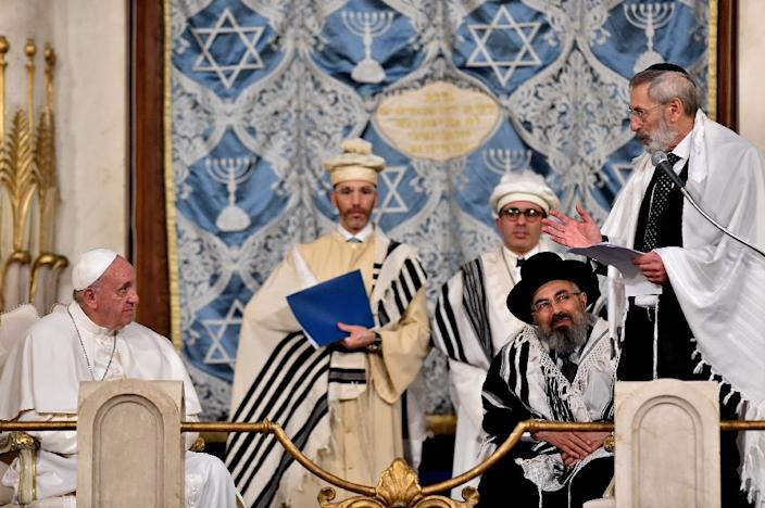 Pope Francis has tried to improve relations between Roman Catholicism and other religions, and visited Rome's main synagogue on January 17, 2016 (AFP Photo/Vincenzo Pinto)