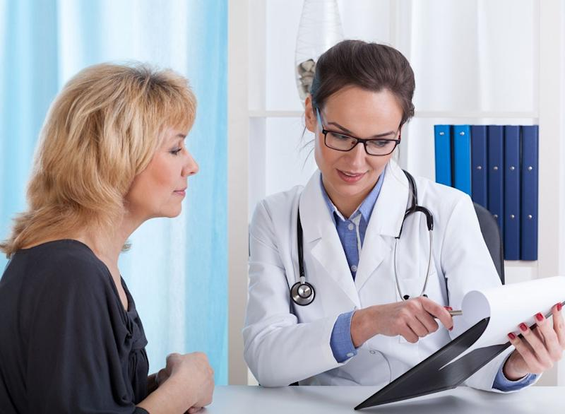doctor discussing treatment patient