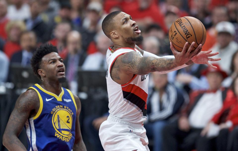 Portland Trail Blazers guard Damian Lillard, right, shoots near Golden State Warriors forward Jordan Bell during the first half of Game 4 of the NBA basketball playoffs Western Conference finals Monday, May 20, 2019, in Portland, Ore. (AP Photo/Craig Mitchelldyer)