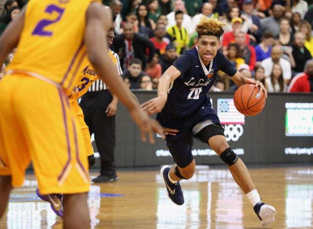In this April 1, 2016, photo, La Lumiere's Brian Bowen (20) in action against Montverde Academy in the DICK'S Sporting Goods High School National Basketball Tournament in Queens, NY. La Lumiere won the game. South Carolina forward and former Louisville recruit Bowen is entering the NBA draft. The school announced Wednesday, April 18, 2018, Bowen won't hire an agent so he could return next season. Bowen transferred to South Carolina amid a federal investigation and has never been cleared by the NCAA to play. (AP Photo/Gregory Payan)