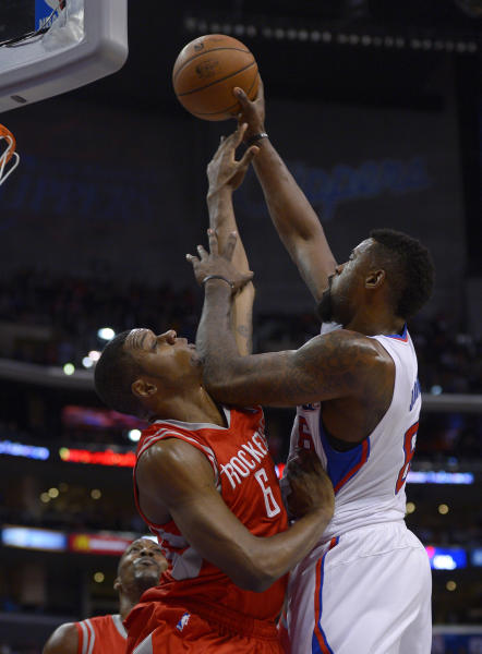Los Angeles Clippers center DeAndre Jordan, right, puts up a shot as Houston Rockets forward Terrence Jones during the first half of an NBA basketball game, Wednesday, Feb. 26, 2014, in Los Angeles. (AP Photo/Mark J. Terrill)