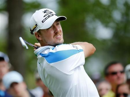 Sweden's Jonas Blixt hits his tee shot on the fourth hole during the final round of the Masters golf tournament at the Augusta National Golf Club in Augusta