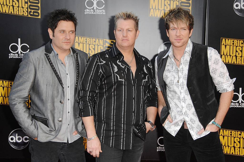 """Rascal Flatts  Grade: B-  Jay DeMarcus, Gary LeVox, and Joe Don Rooney clearly spent more time on styling their hair than picking out their casual gray and black ensembles! Steve Granitz/<a href=""""http://www.wireimage.com"""" target=""""new"""">WireImage.com</a> - November 22, 2009"""