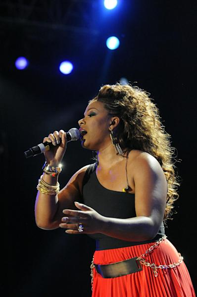 """FILE - In this July 8, 2012 photo, Syleena Johnson performs a tribute to Whitney Houston at the Essence Music Festival in New Orleans. TV reality show, """"R&B Divas,"""" which airs Mondays at 10 p.m. EDT has an episode that shows the women's tribute performance from the 2012 Essence Music Festival honoring Whitney Houston, Etta James and others. (Photo by Cheryl Gerber/Invision/AP, File)"""