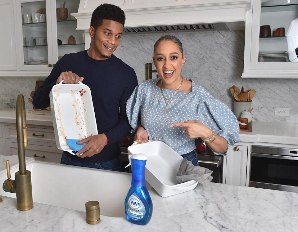 <p>Tia Mowry and husband Cory Hardrict tag team the dishes in the kitchen with Dawn soap.</p>