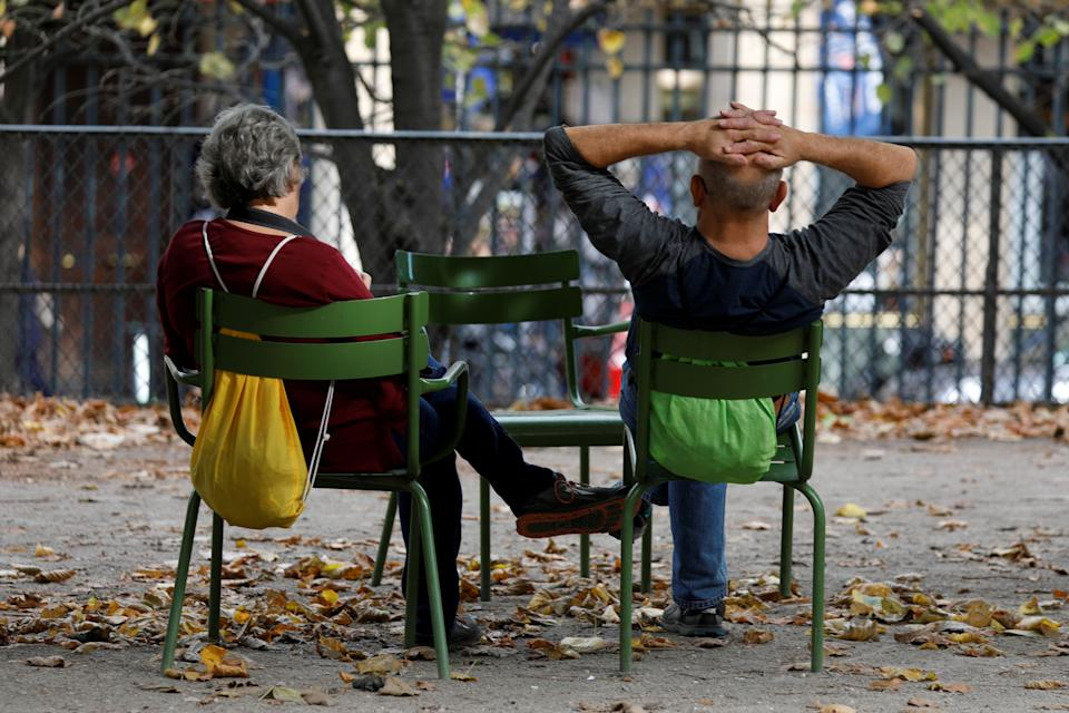 Elderly people sit in the Jardin des Tuileries in Paris, France, October 12, 2018.   REUTERS/Charles Platiau