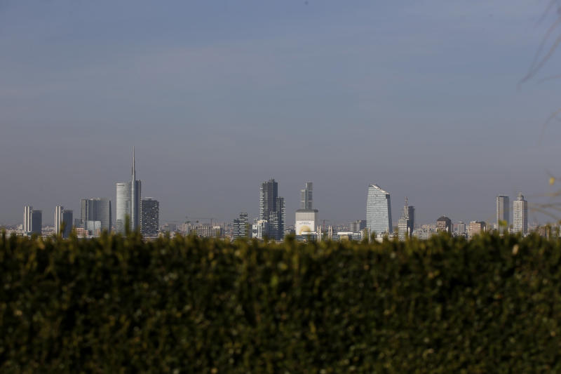 In this photo taken on Wednesday, Oct. 25, 2017, the skyline seen from the roof of Martini Terrace, in Milan, Italy. The eurozone's third-largest economy and a major exporter, Italy on Wednesday becomes the first western industrialized nation to idle swaths of industrial production to stop the spread of coronavirus by keeping yet more of the population at home. The new coronavirus causes mild or moderate symptoms for most people, but for some, especially older adults and people with existing health problems, it can cause more severe illness or death. (AP Photo/Luca Bruno, File)