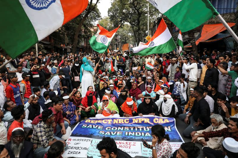 Demonstrators shout slogans during a protest against a new citizenship law in Kolkata