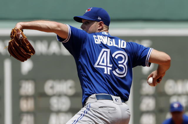 Toronto Blue Jays pitcher Sam Gaviglio delivers against the Boston Red Sox during the first inning of a baseball game Saturday, July 14, 2018, in Boston. (AP Photo/Winslow Townson)