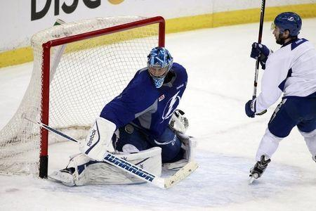 Tampa Bay Lightning goalie Ben Bishop (30) makes a save as he works out during media day the day before the 2015 Stanley Cup Final at Amalie Arena; Jun 2, 2015; Tampa, FL, USA; Kim Klement-USA TODAY Sports