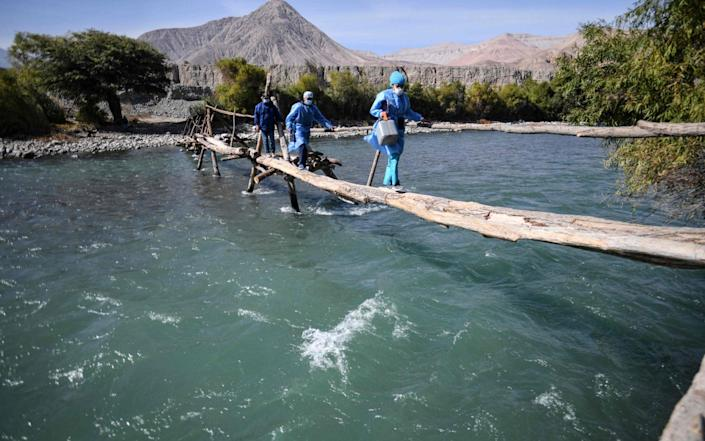 In Arequipa, southern Peru, they have to cross fast rivers on tiny, rickety bridges - Diego Ramos/ AFP via Getty Images
