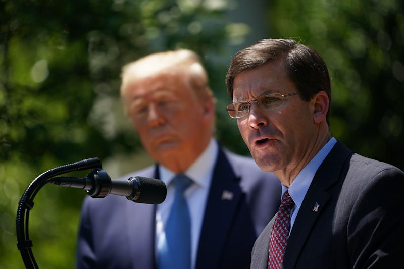 Defense Secretary Mark Esper, with President Donald Trump, speaks on vaccine development on May 15, 2020, in the Rose Garden of the White House. (Photo: MANDEL NGAN via Getty Images)