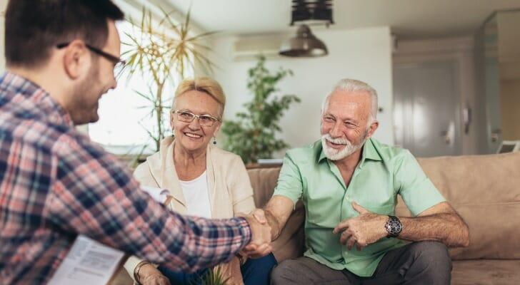 Couple discusses their investment portfolio with a financial advisor