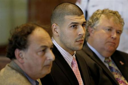 Former New England Patriots NFL football playerAaron Hernandez, (C), sits with his attorneys James Sultan (L) and Michael Fee in Bristol Superior Court in Fall River, Massachusetts, October 21, 2013. REUTERS/Stephan Savoia/ Pool