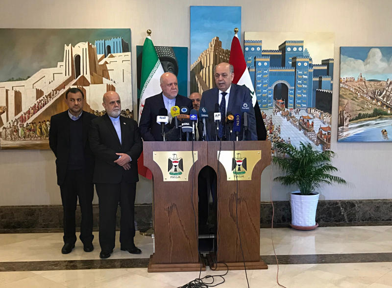 Iraqi Oil Minister, Thamir Ghadhban, center, and Iranian Oil Minister Bijan Zanganeh, hold a press conference in Baghdad, Iraq, Thursday, Jan. 10, 2019. (AP Photo/Ali Abdul Hassan)