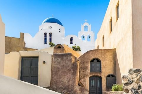 Santorini's beauty has made it an in-demand destination - Credit: TURTIX