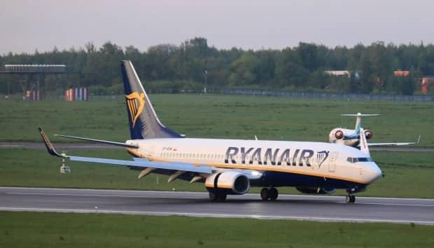 The Boeing 737-8AS Ryanair plane from Athens that was intercepted and diverted to Minsk by Belarusian authorities is shown after landing at the international airport in Vilnius, Lithuania, its initial destination, on Sunday. An opposition journalist on the plane was arrested. (Petras Malukas/AFP/Getty Images - image credit)