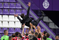 Atletico Madrid's head coach Diego Simone is lifted in the air by his players at the end of the Spanish La Liga soccer match between Atletico Madrid and Valladolid at the Jose Zorrilla stadium in Valladolid, Spain, Saturday, May 22, 2021. Atletico won 2-1 and clinches its 11th Spanish La Liga title. (AP Photo/Manu Fernandez)