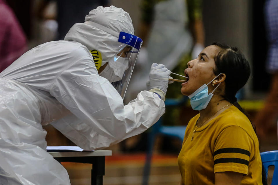 File photo of health workers in protective suits conducting Covid-19 testing in Kuala Lumpur April 12, 2020. — Picture by Firdaus Latif