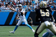 Carolina Panthers quarterback Sam Darnold passes against the New Orleans Saints during the first half of an NFL football game Sunday, Sept. 19, 2021, in Charlotte, N.C. (AP Photo/Jacob Kupferman)
