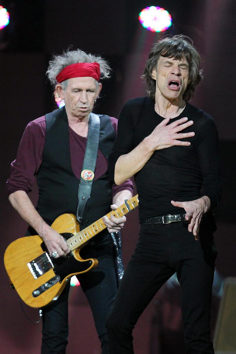 In this image released by Starpix, Keith Richards, left, and Mick Jagger of The Rolling Stones perform at 12-12-12 The Concert for Sandy Relief at Madison Square Garden in New York on Wednesday, Dec. 12, 2012. Proceeds from the show will be distributed through the Robin Hood Foundation. (AP Photo/Starpix, Dave Allocca)